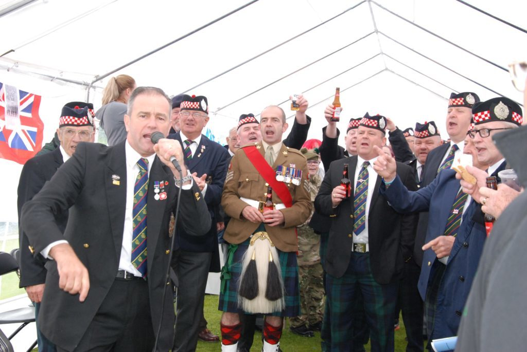 The unofficial veterans choir belts out the Argylls' anthem Bonnie Mary o' Argyll, conducted by Andrew Gibson from Paisley. 06_a25AFD08