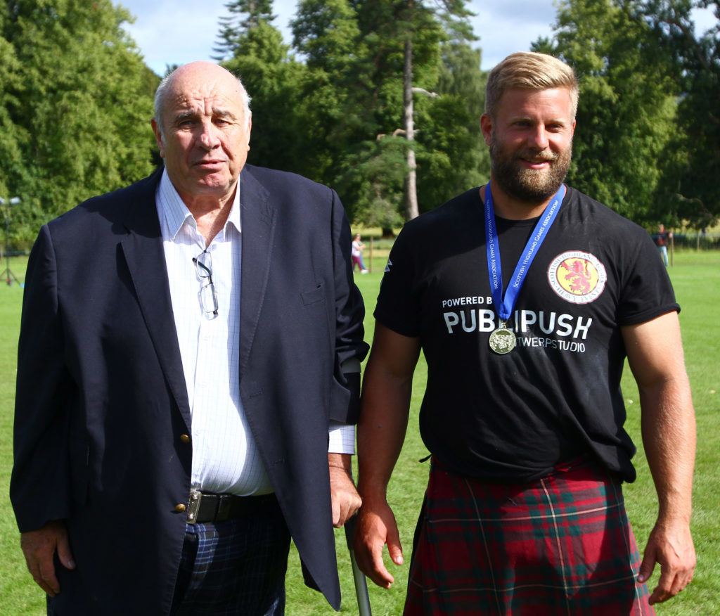 Donald Clark, George Hotel, sponsor of the World Caber Champion competition with Scott Rider World Caber Tossing Champion. Photograph: Kevin McGlynn