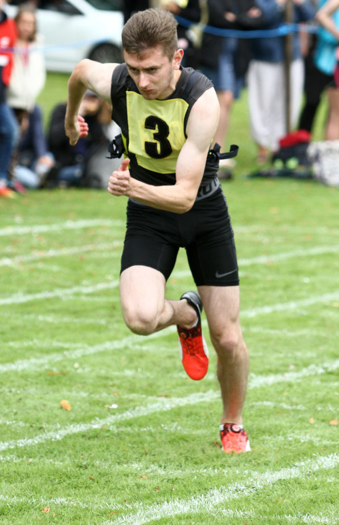 Ben Coates, Kilmore, on his way to winning the 60m sprint title at Inveraray Highland Games. Photograph: Kevin McGlynn