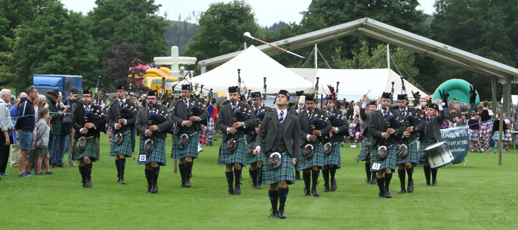 Inveraray and District pipeband march on to the field to start Inveraray Highland Games. Photograph: Kevin McGlynn