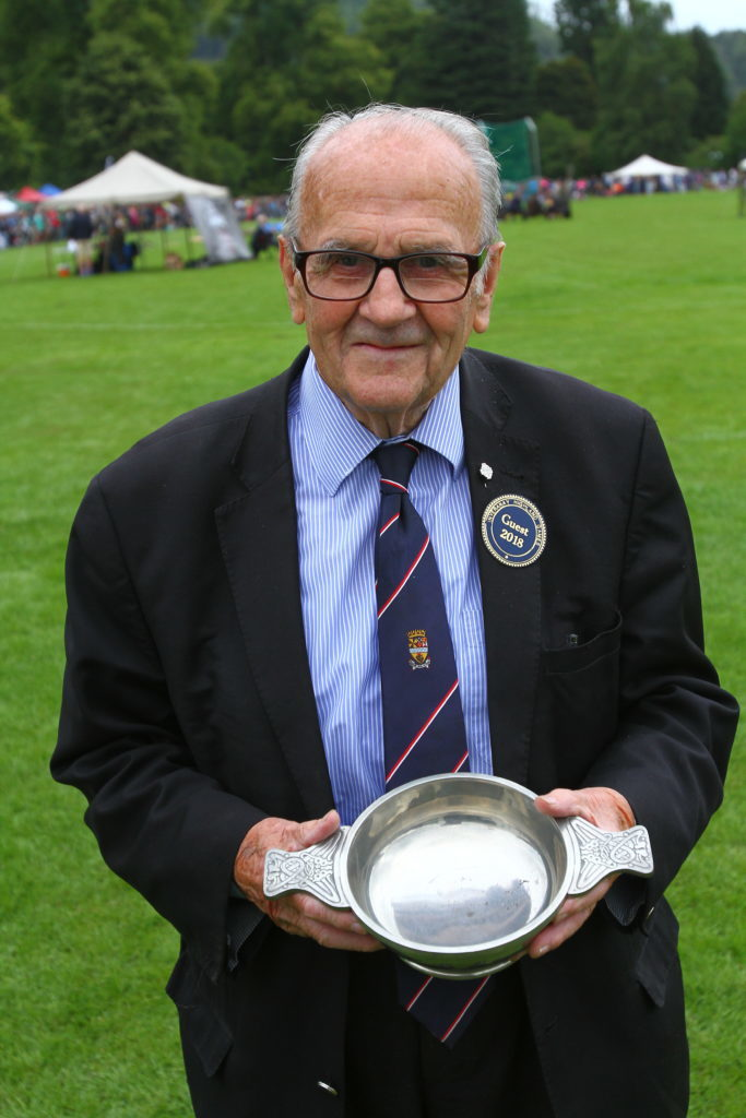 Councillor Donnie MacMillan 90 with the trophy presented to Inveraray Highland Games for his late son Josie MacMillan who passed away suddenly 10 years ago. Donnie has not missed many of the games at Inveraray, but this year he was only there to watch, not to compete. Photograph: Kevin McGlynn