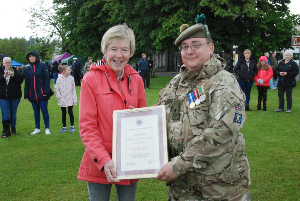 Army Cadet Force Lieutenant David Sinclair, described as 'modest, calm, measured and professional', received a promotion - and a certificate for meritorious service, presented by Jane MacLeod, Vice Lord Lieutenant of Argyll and Bute
