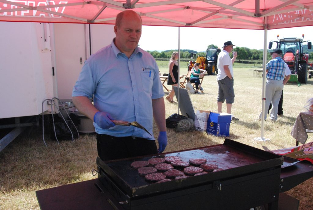 Jim Steel in charge of the burgers