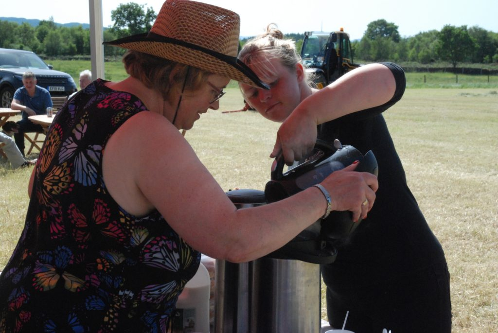 Maureen Steel and daughter Heather keep the tea urn filled. Heather's sister Kirsty was also hard at work keeping the customers fed and watered