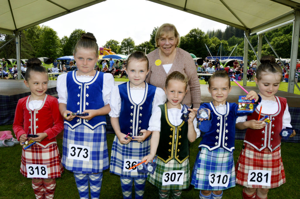 Dancing convenor Myra Miller has been helping to run the event for more than 30 years. She is seen here with winners from the primary classes. JS29INVGAMES33