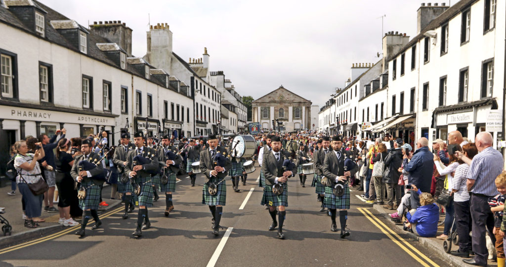 Inveraray and District Pipeband European Champions lead the parade down the main street to the games field. Photograph: Kevin Mcglynn