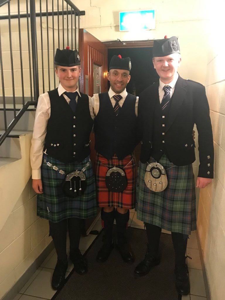 Camron MacPhail, left, and Christopher McCartan, right, with Alisdair McLaren, director of the National Youth Pipe Band of Scotland
