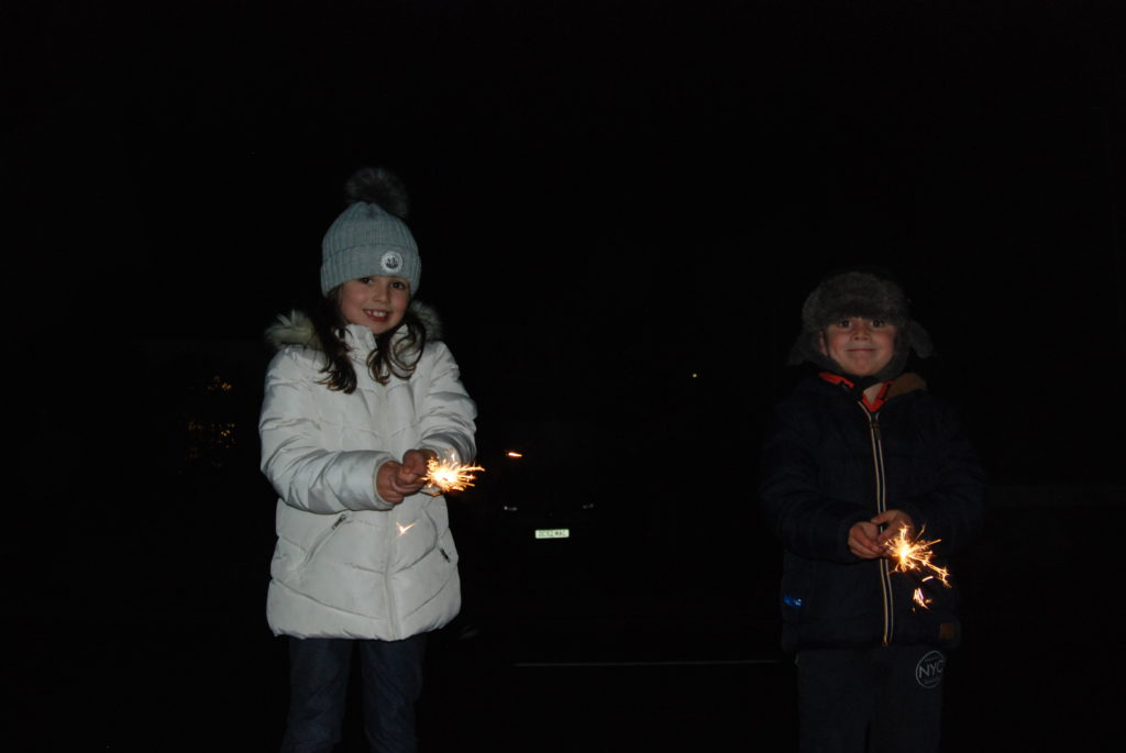 Miley and Archie McCallum with sparklers shining