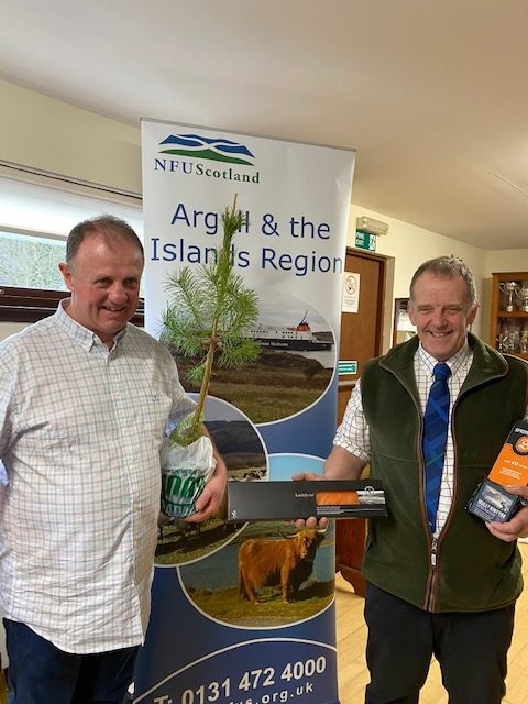 Newly-elected chairman Duncan McAllister (left) and his predecessor John Dickson, laden with Argyll and the Isles gifts