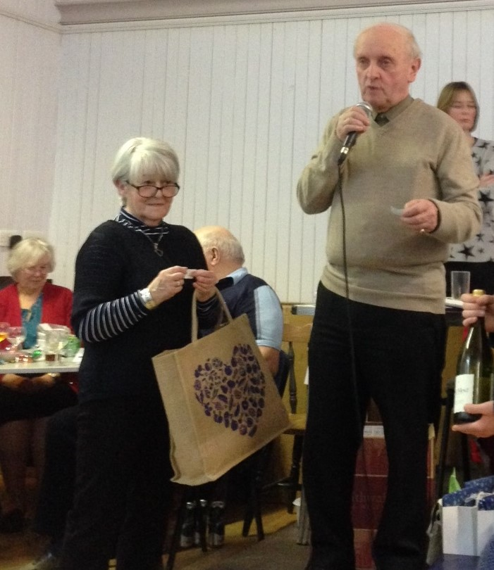 Roddy announces the raffle, ably assisted by Greta Cameron