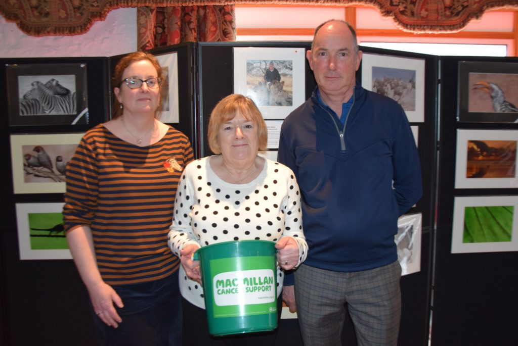 Carol's sister Evelyn and brother Colin with chairwoman of the Lochgilphead and District Macmillan fundraising committee Cathy Robertson