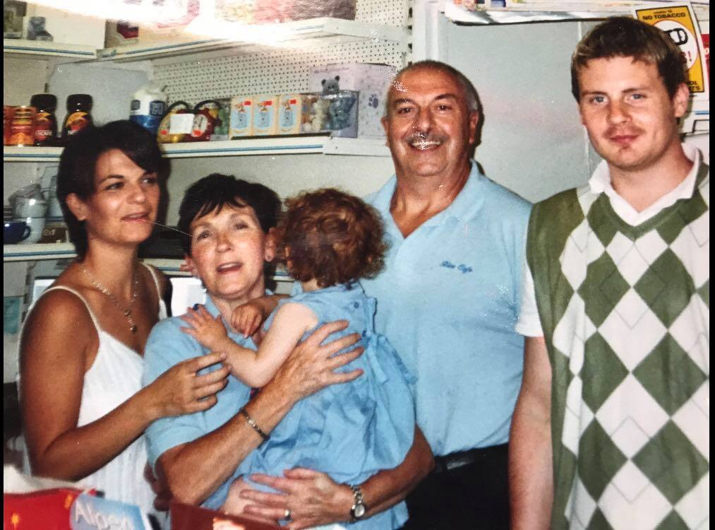 Nic and her husband John with their daughter and Garry and Neilina in 2006, a year before the cafe was sold
