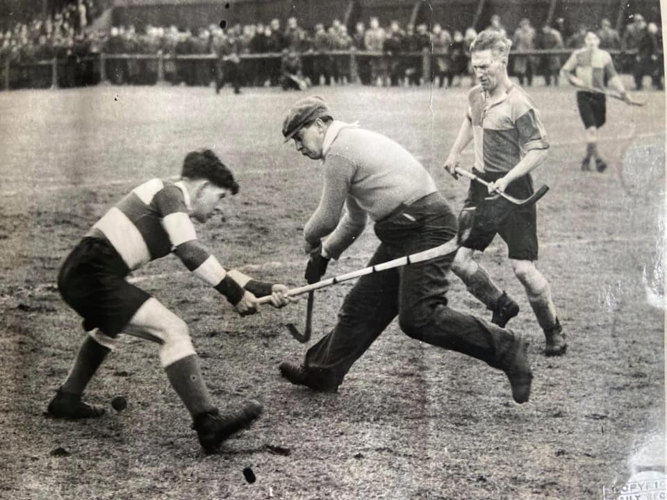 Bunty Crawford in goal for Lochfyneside in the 1947 Camanachd Cup Final, played at Mossfield, Oban. Nearest the camera is Johnny Campbell of Newtonmore, with Lochfyneside defender Donald Beaton lending a hand.