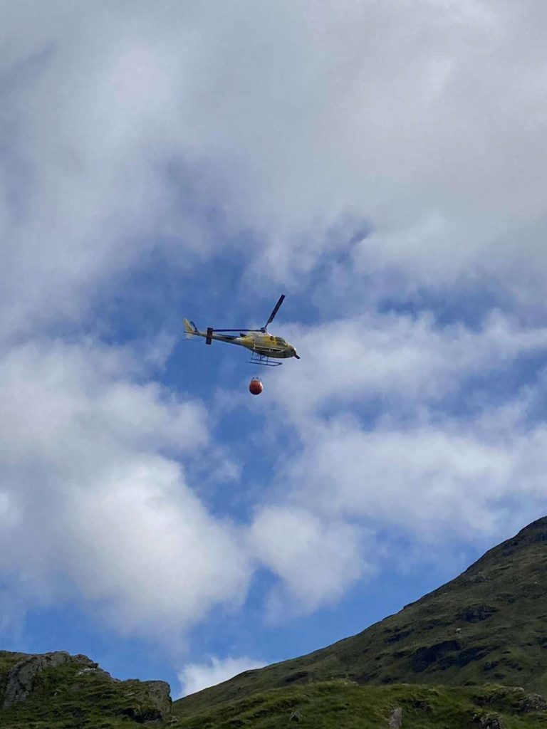 A helicopter was brought in to help clear boulders from the stricken route following the landslide on Tuesday.