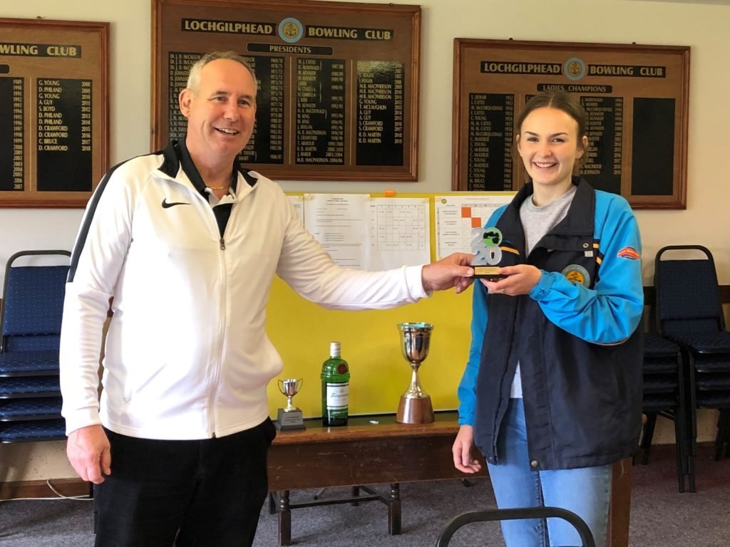 Hannah Johnson receives her ladies singles trophy from Roddy MacDonald