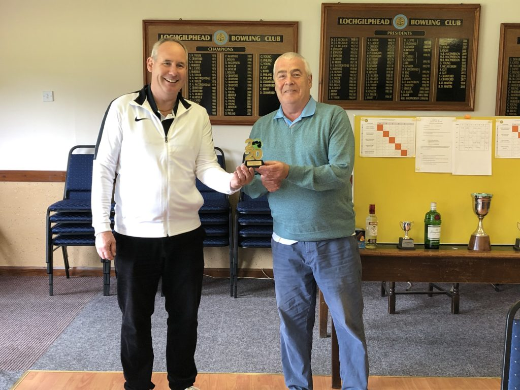 Club president Roddy MacDonald presents trophy to Ian Guy, winner of the gents singles on August 15