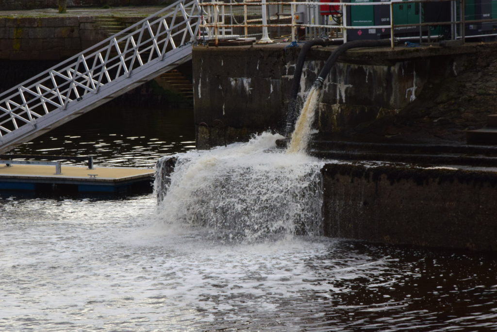 Water is pumped from the sea lock into Ardrishaig harbour