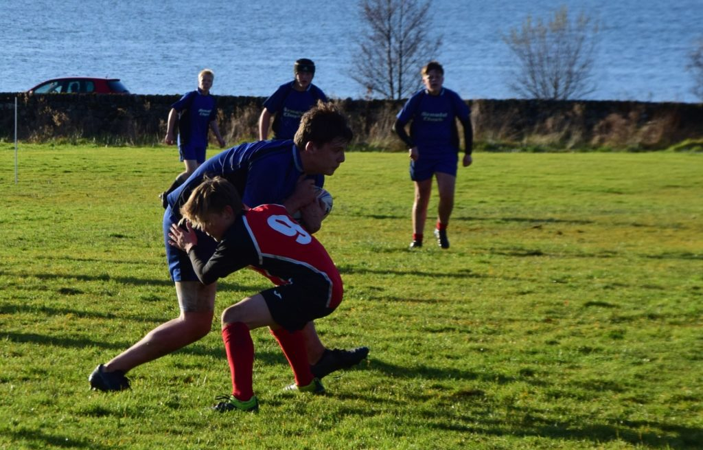 SA'S scrum half Calum Patterson making the big hit to stop the Boclair attack