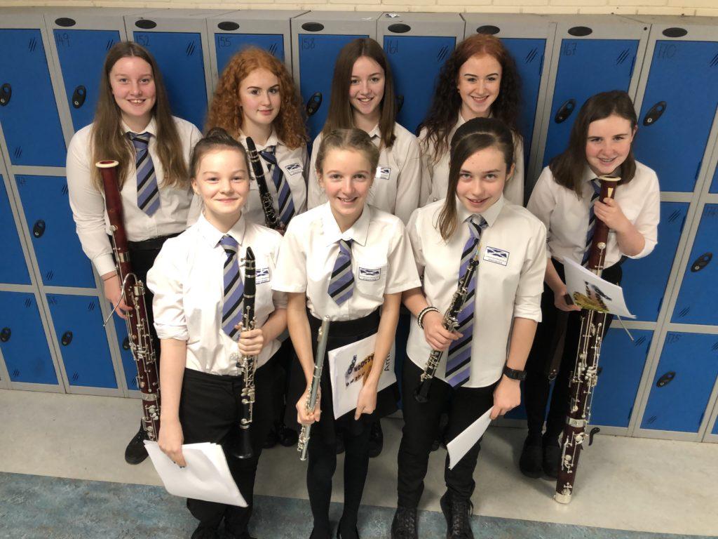 School ensemble busks at Co-op