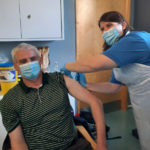 Scottish Ambulance Service Paramedic D.A. MacInnes, who recently became one of the first people on Uist to receive the Covid-19 vaccination, is seen receiving the jab fromNHSWesternIslesOccupational Health Nurse, Marion Campbell. NO F03 First Covid19 vaccine Uist
