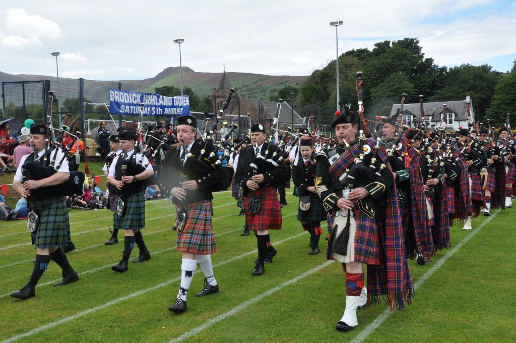 The joint pipe bands entertain the crowds.