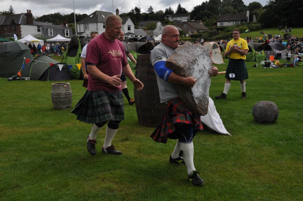 Ewan Cameron lifts another heavy stone.