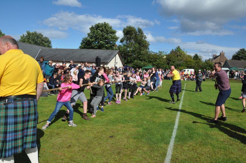 Children take on the tug-of-war challenge.