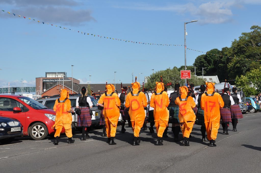 The drum section of the Arran Pipe Band dressed as lions.