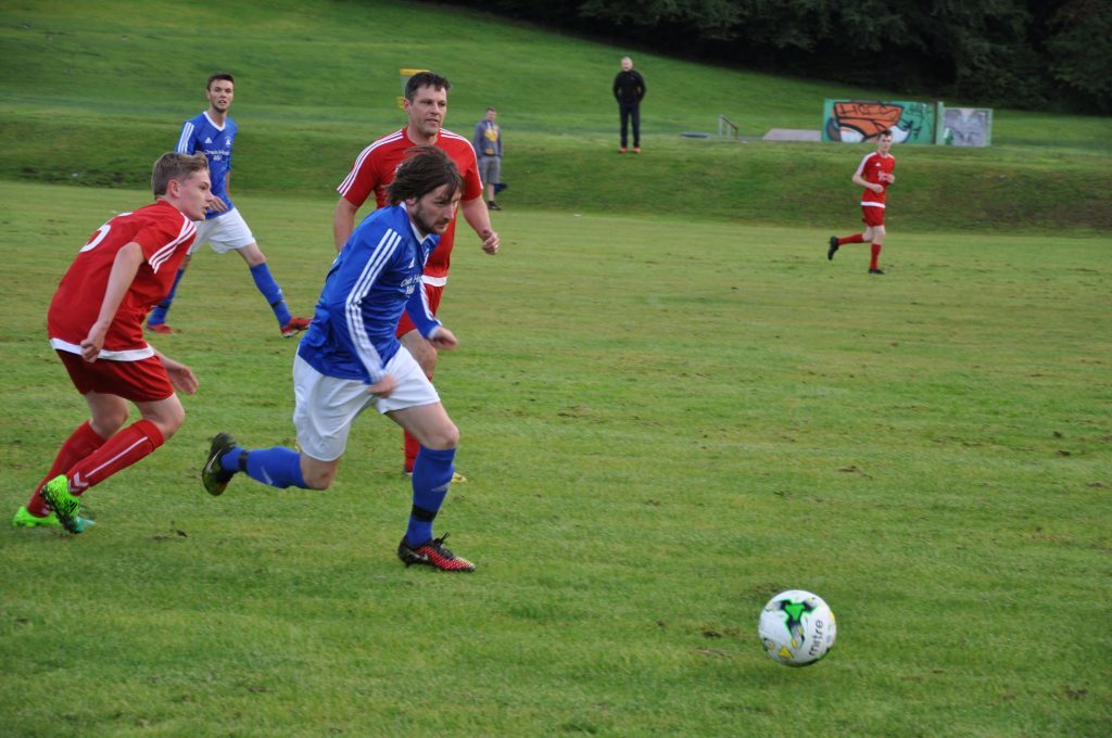 Owen 'Pele' Quigley evades the opposition to surge forward with the ball.