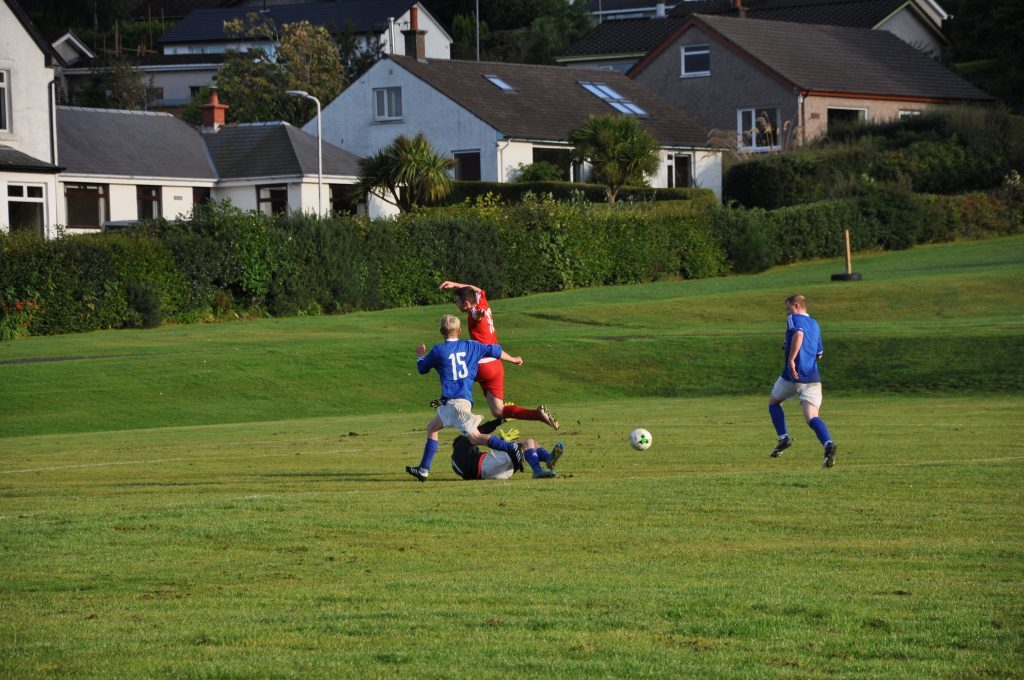 Goalkeeper Archie McNicol comes out of the box to prevent a Shiskine attempt at goal.
