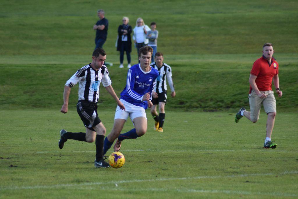 Sean Higgins drives the ball forward for his Lamlash team mates