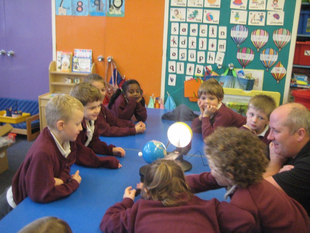 Children enjoy using the tactile models that teach the basics of astronomy