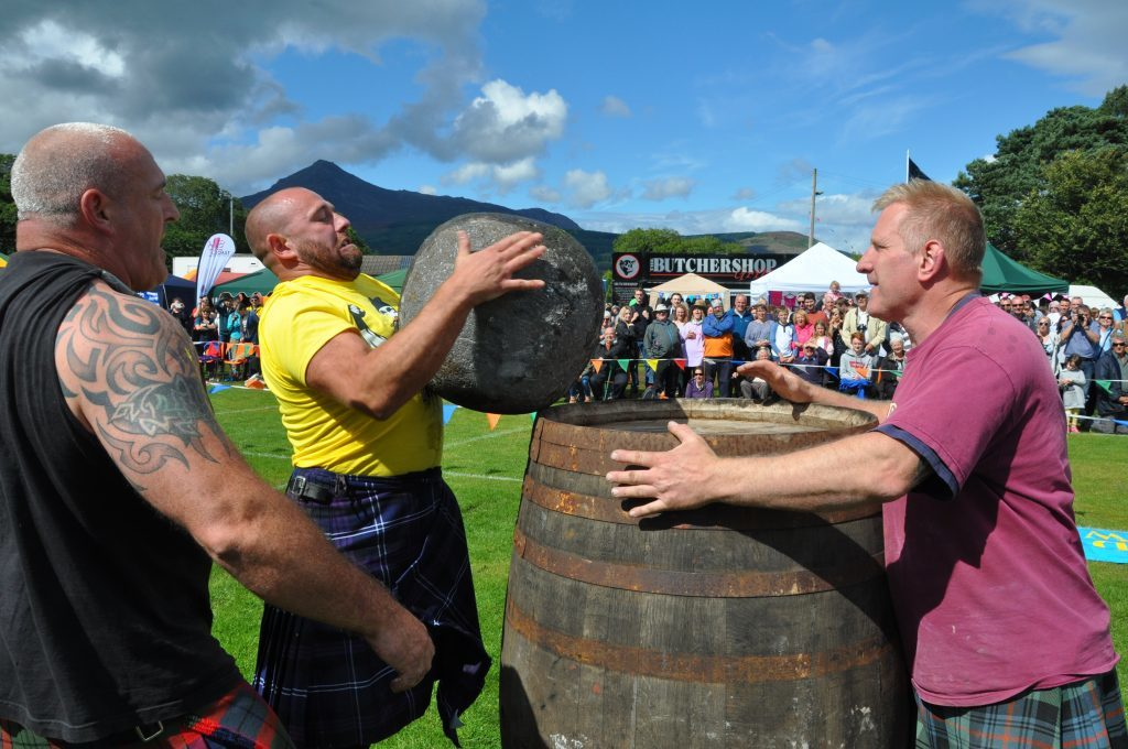 August - Record crowds attended the Brodick Highland Games where Tom Gilmore successfully lifted one of the McGlashan stones