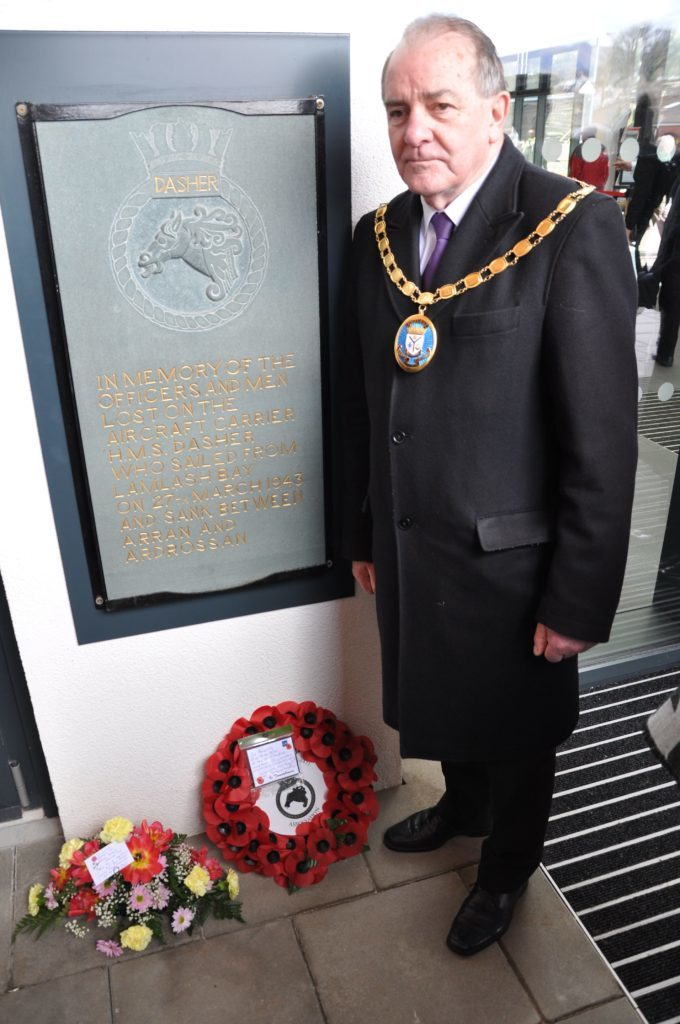 Provost Ian Clarkson pays his respects at the new memorial plaque at the Brodick ferry terminal