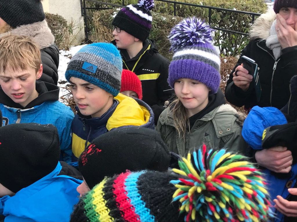 Competitors dressed for the cold prepare for their race