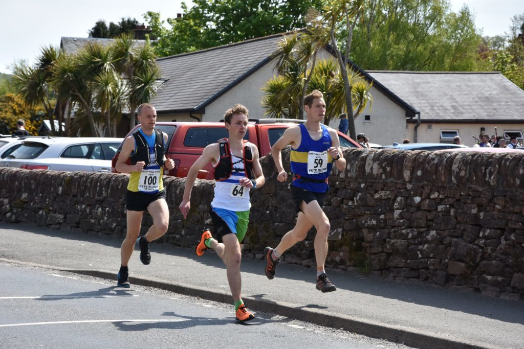 Leading the pack from the start of the race are eventual first and second place winners, Tom Owens and John Yells.