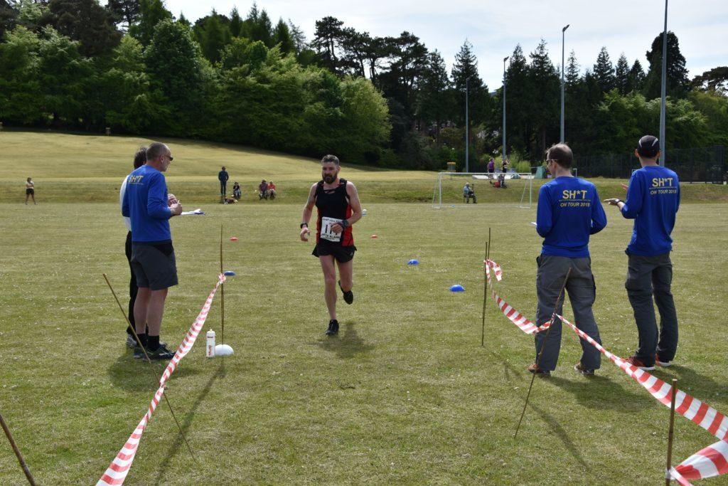 Last year's local winner, Jon Smith of Arran Fell Runners, crosses over the line.