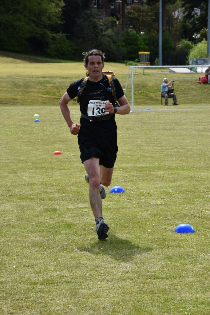 First time hill race runner, Andy McNamara, completes the race.