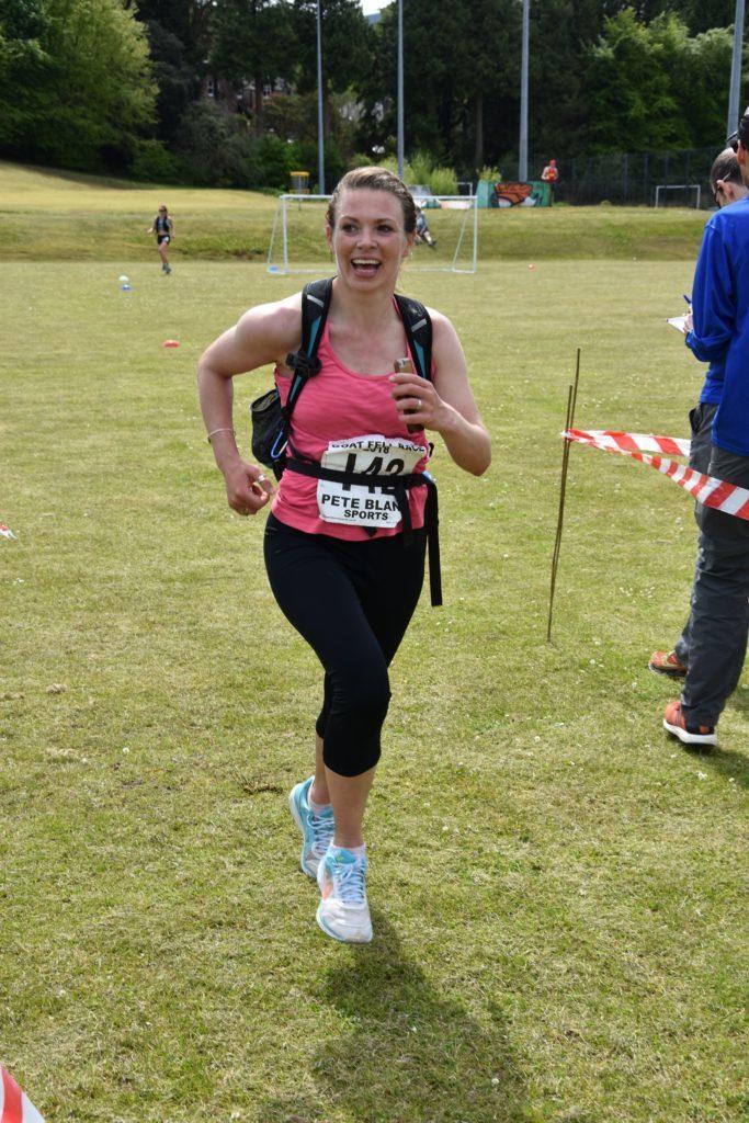 Familiar face on Arran, Hannah McLellan smiles as she finishes the race.