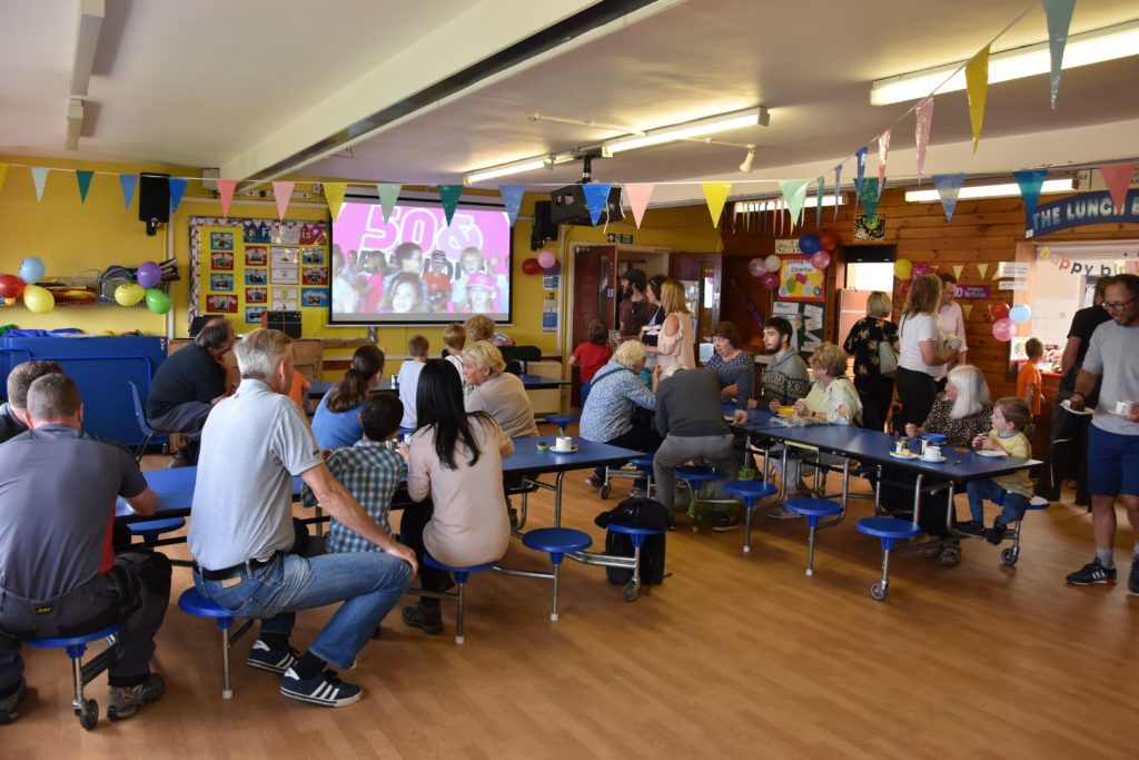 Visitors and parents enjoy a short film featuring the pupils while enjoying refreshments.