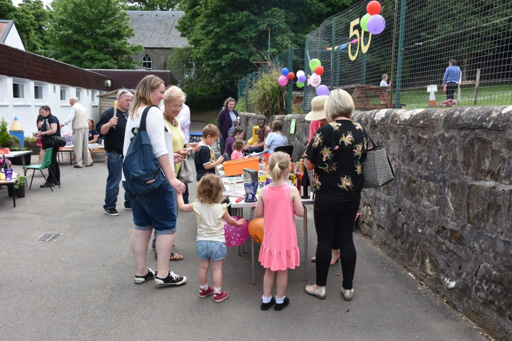 Visitors have a go at winning fun prizes at the tombola.