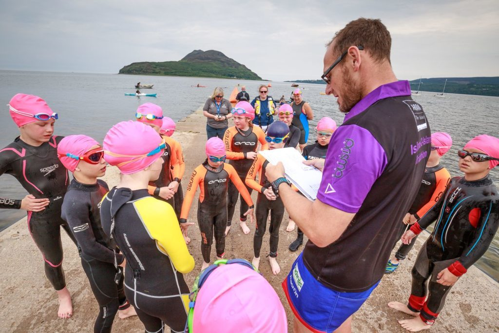 Junior swimmers prepare to set off for their swim during their Aquathlon.