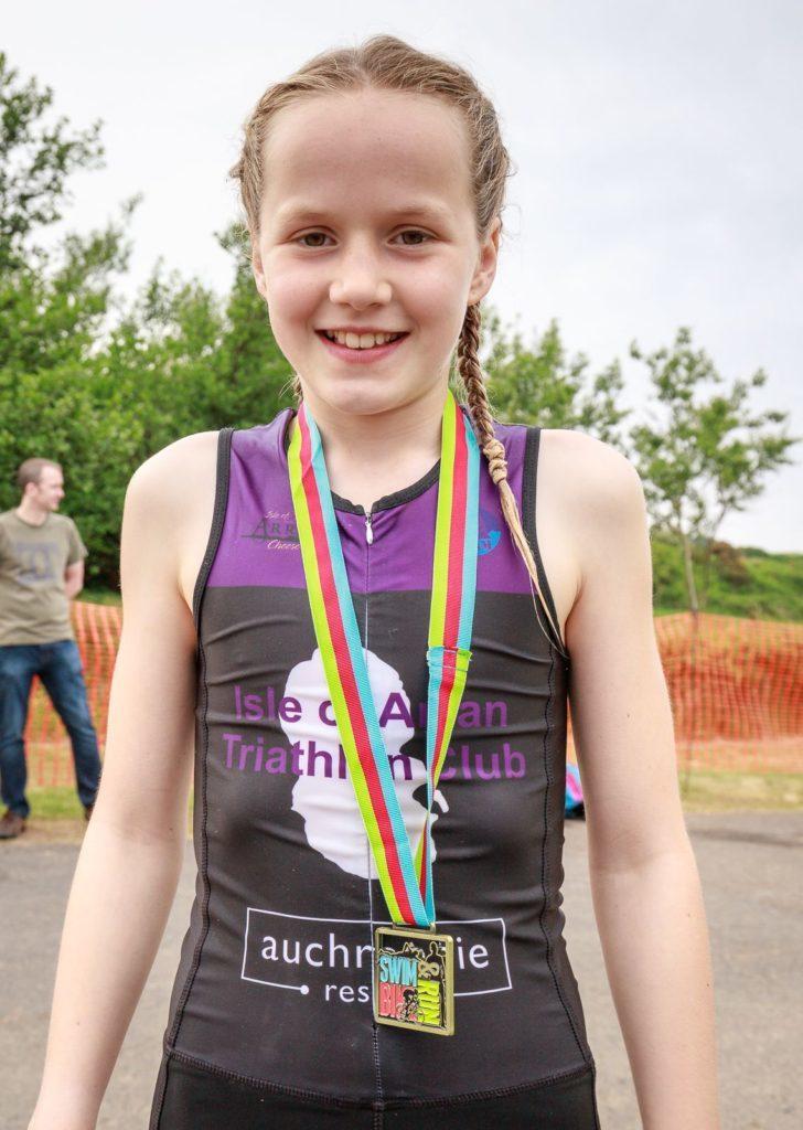 Tristar 1 winner, Rhea Webster with her medal.