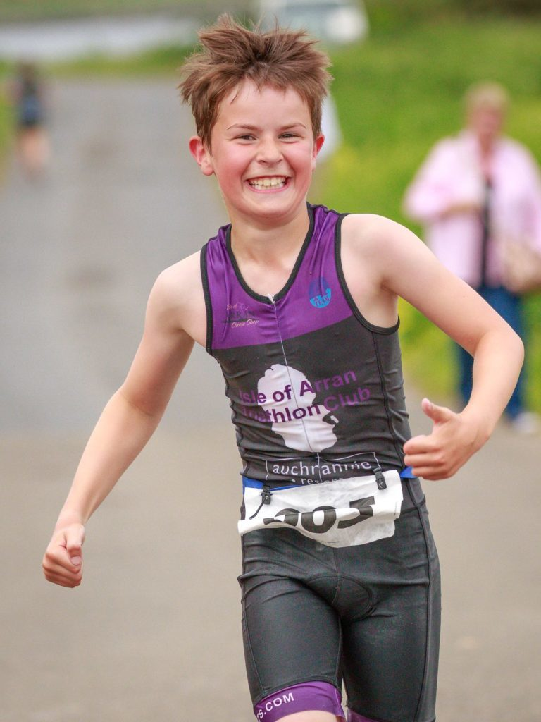 Jack Popplewell is all smiles during his run.