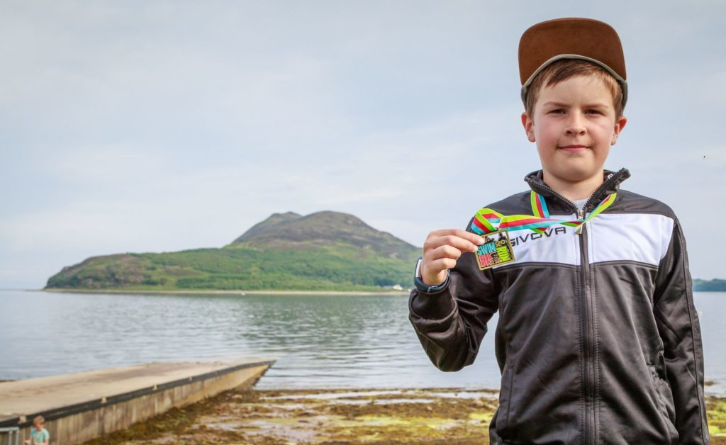 Jack Popplewell pictured with his medal.