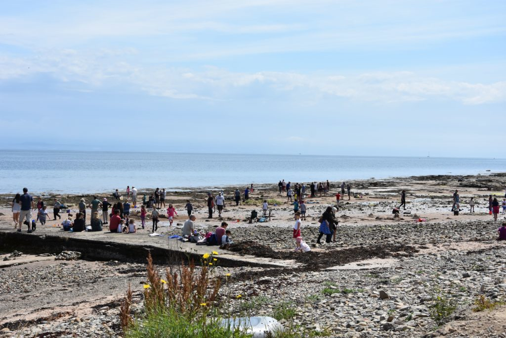 Whiting Bay beach was filled with families enjoying the sea, sand and sunshine.