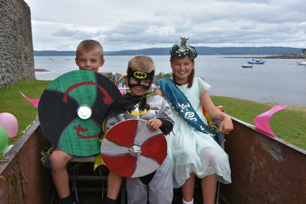 Sea Queen Daisy Innes and King Michael Innes are joined on their float by Viking Batman.