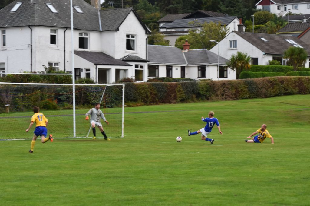 Brodick's Matt Keir puts his all into a powerful attempt at goal.