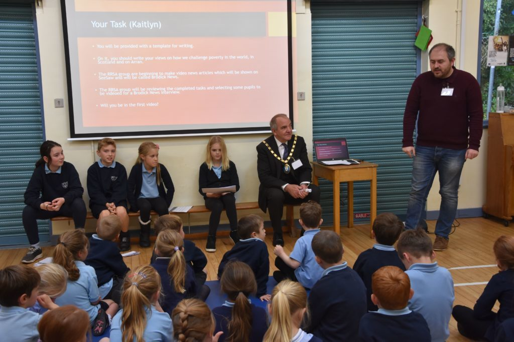 Council leader Joe Cullinane speaks to Brodick Primary School pupils about their perceptions of poverty.