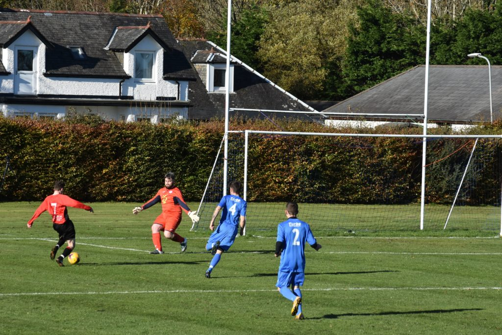Johnny Sloss opens the scoring with a left footed kick at goal.